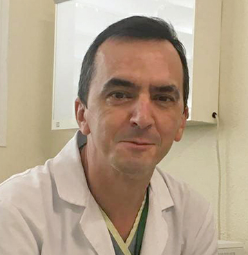 Dr. JULIÁN OLALLA